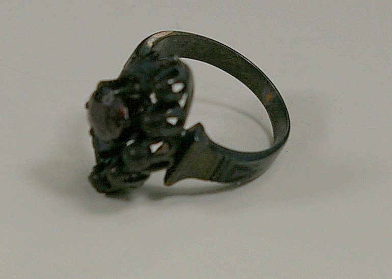 Fire Damaged Jewelry Restoration at Crane Jewelers Ltd.  Victorian Ruby Ring side view burnt.JPG
