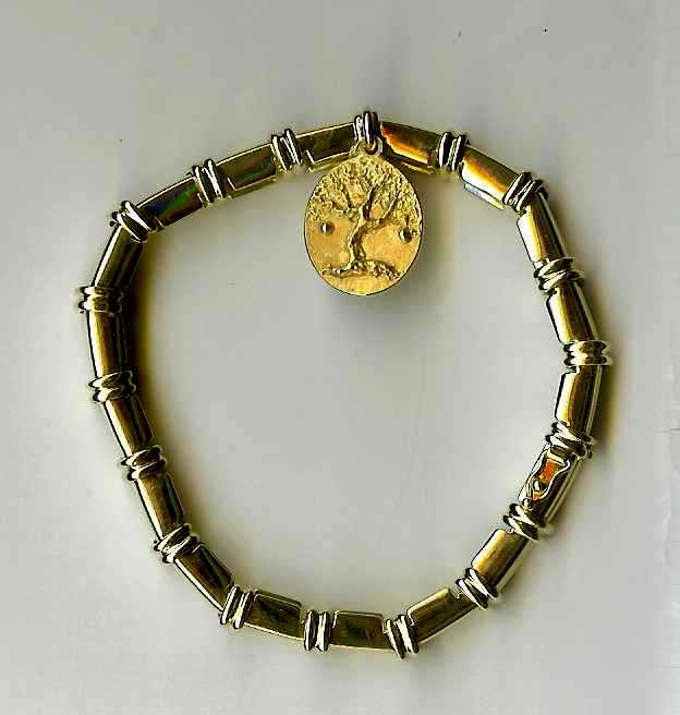 # H192 Apple tree Charm on 18 Karat gold bracelet Barrow Fire.jpg