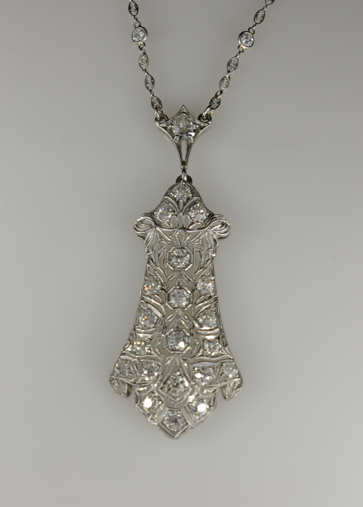 The restoration of an Edwardian Platinum Necklace at Crane jewelers front of finished piece 1a.JPG