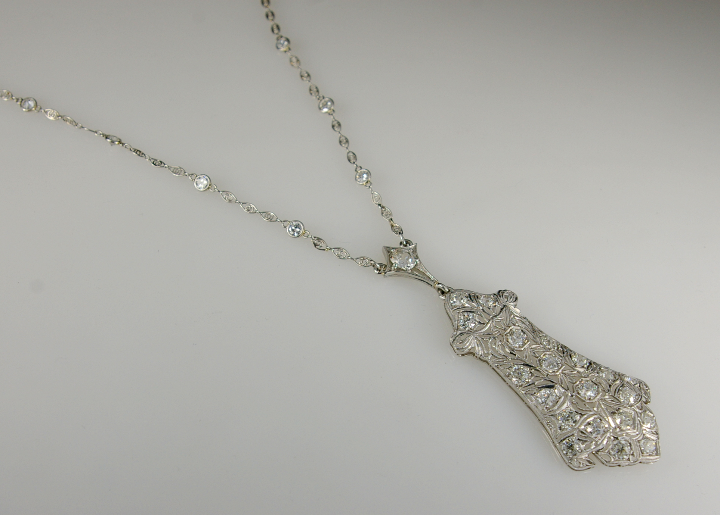 The restoration of an Edwardian Platinum Necklace at Crane jewelers front of finished piece.JPG