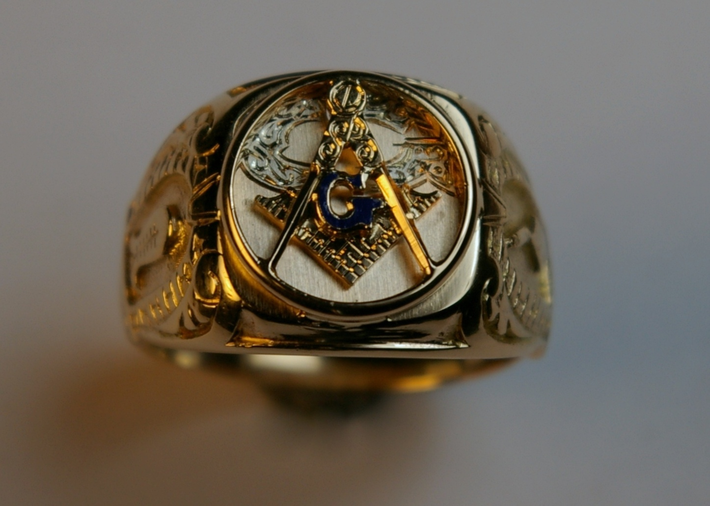 Masonic master ring closeup of square and compass