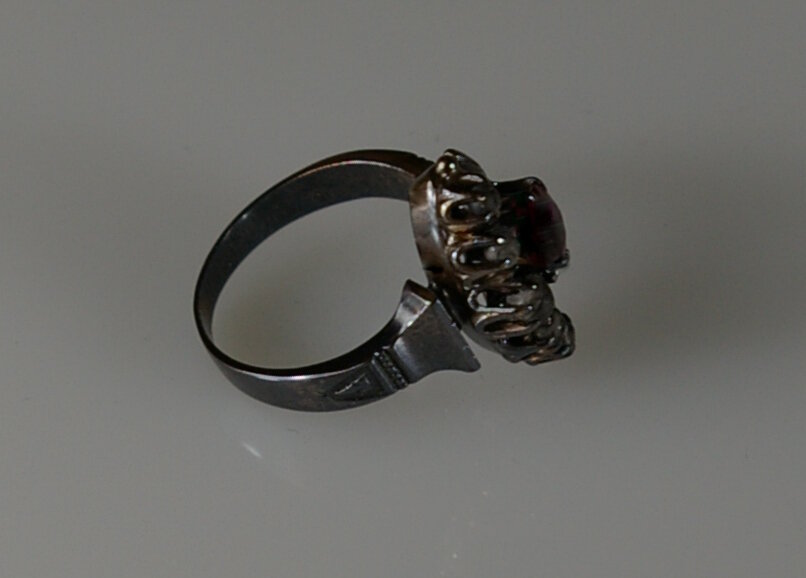 Fire Damaged Jewelry Restoration at Crane Jewelers Ltd. the before picture of a Victorian Ruby Ring
