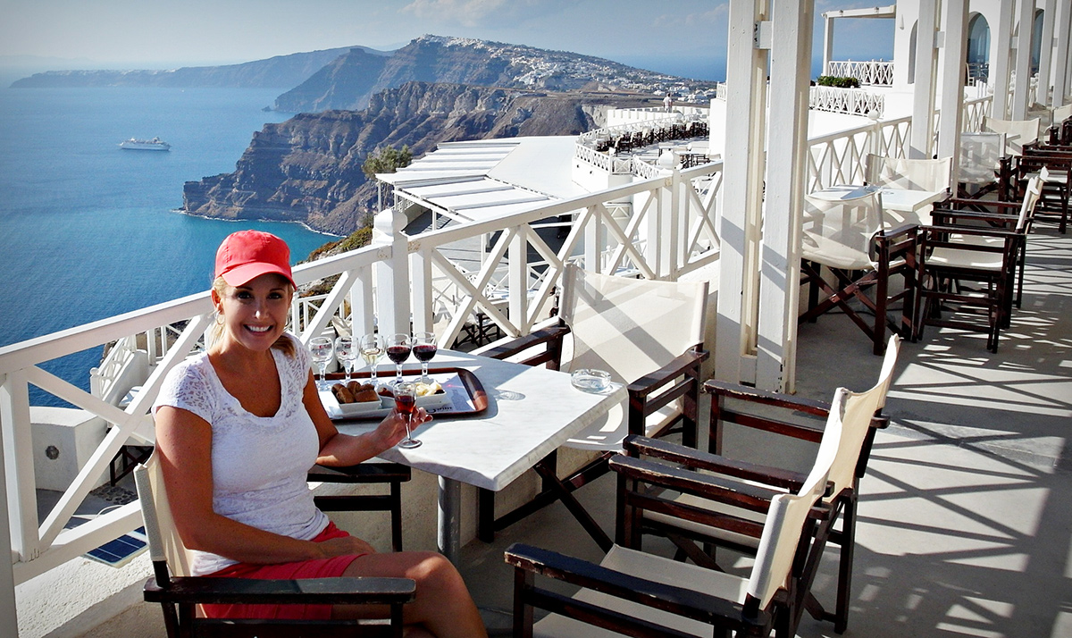 Relaxing with food and wine along the coast of Greece.