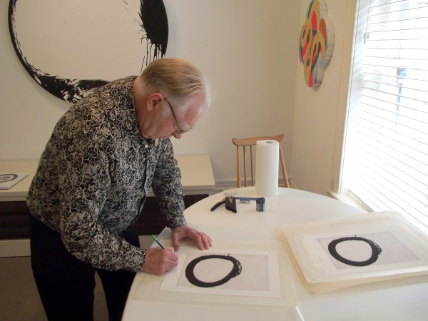 Max-Gimblett-signing-the-Enso-editon-18th-MArch-2015-600x450.jpg