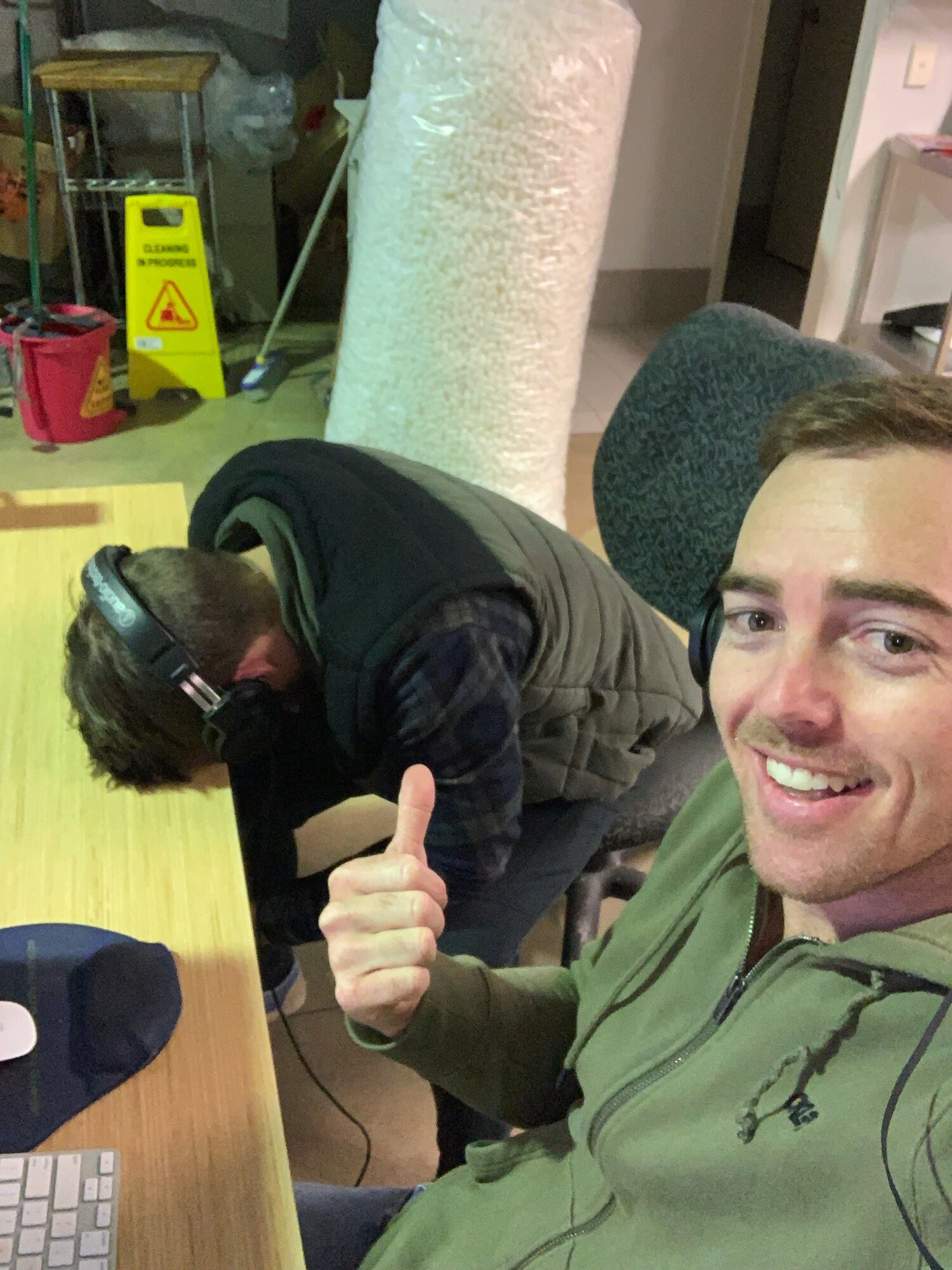At the factory, editing and listening to recordings for an episode. Tom resting his head.