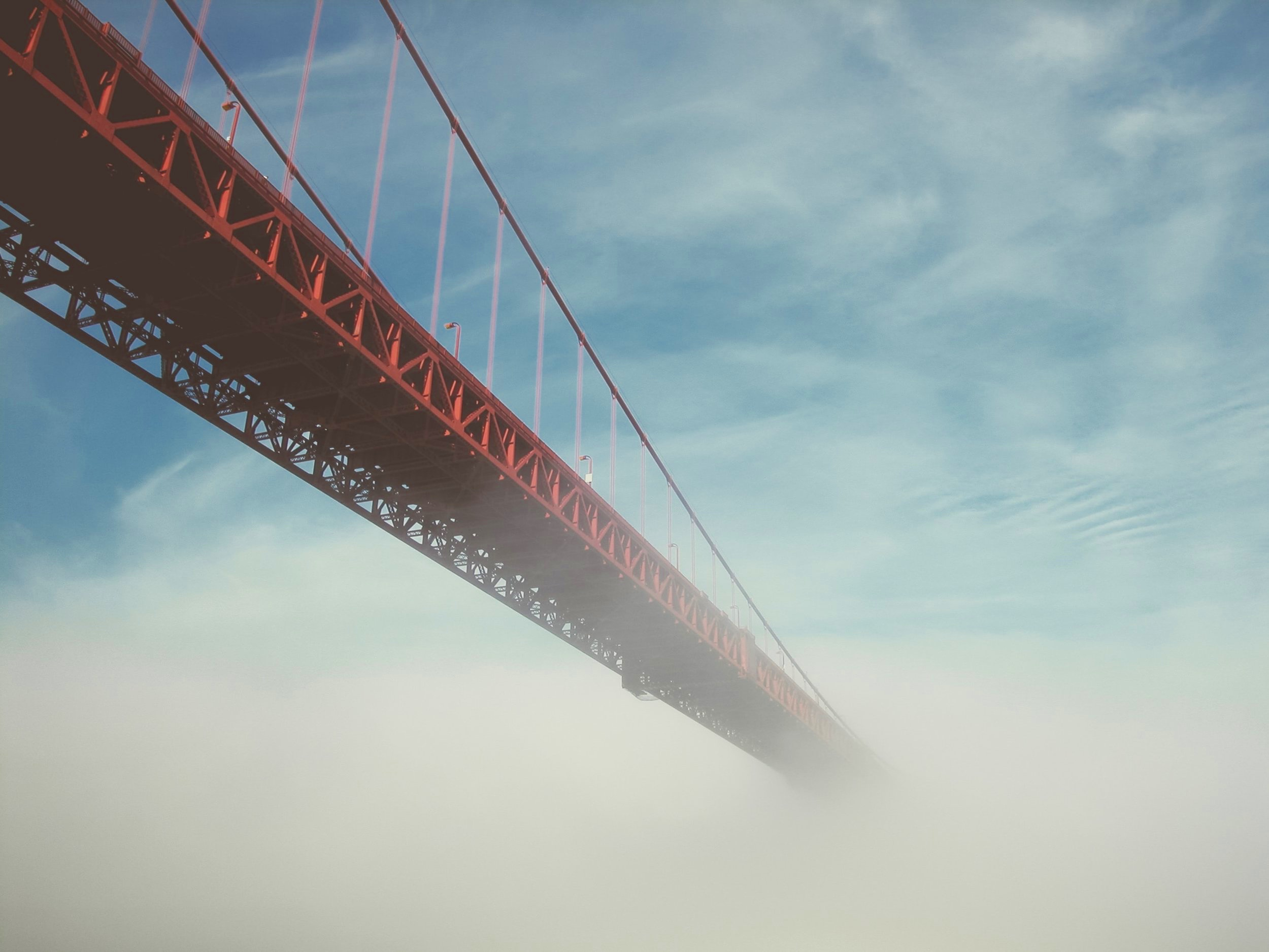 Imagine what may be at the end of this bridge. - Photo by Simon Stratford | Unsplash