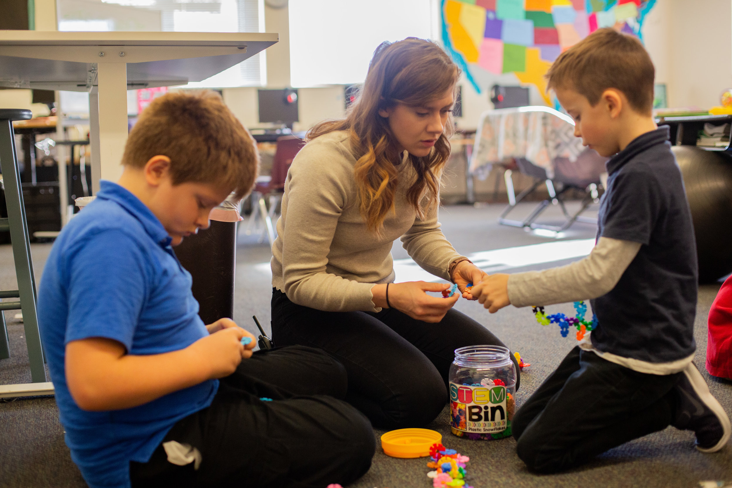 Miss Weems assisting students in daily STEM building.