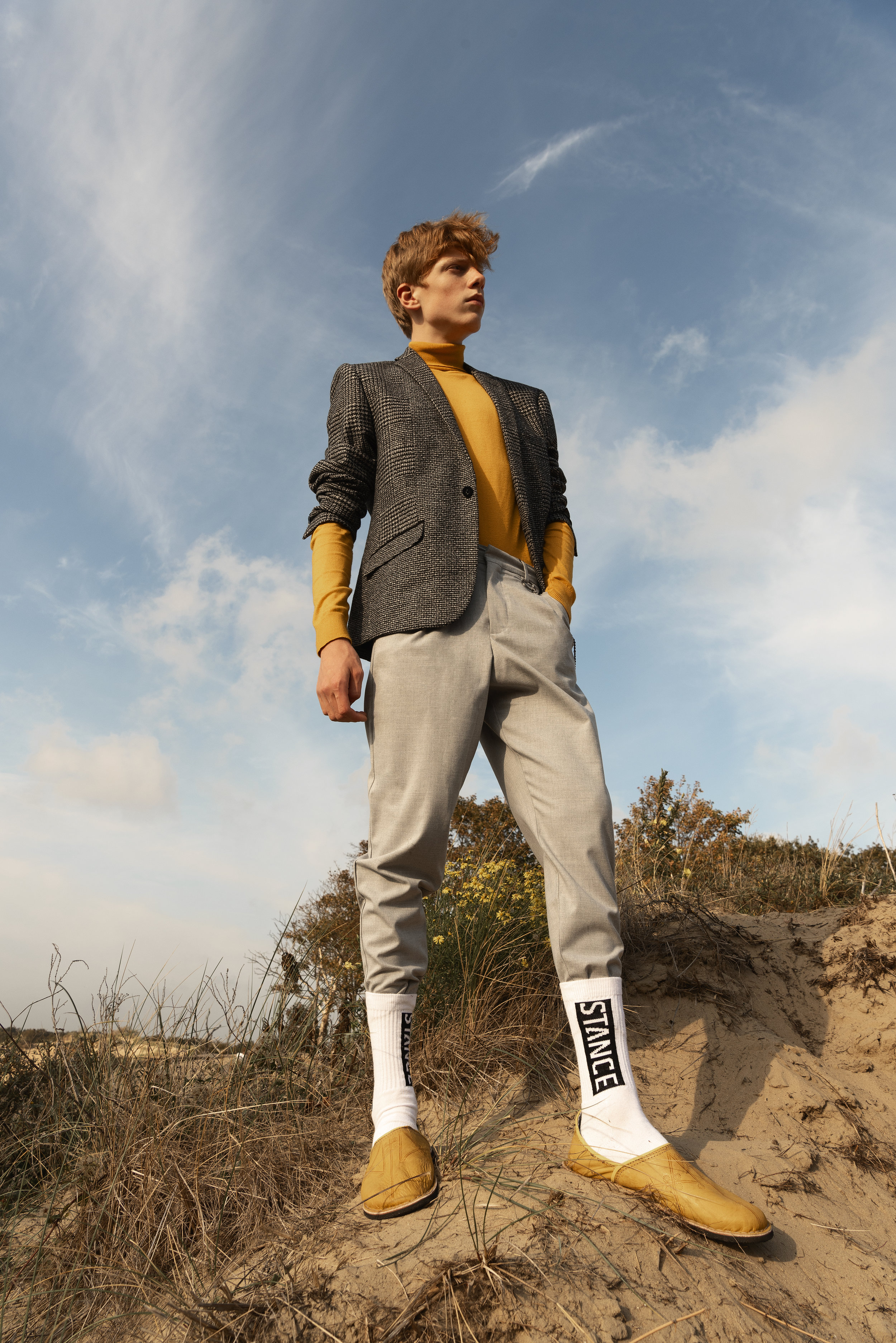 Turtle neck and jacket River Island, pants Pull and Bear, socks and shoes stylist wardrobe.