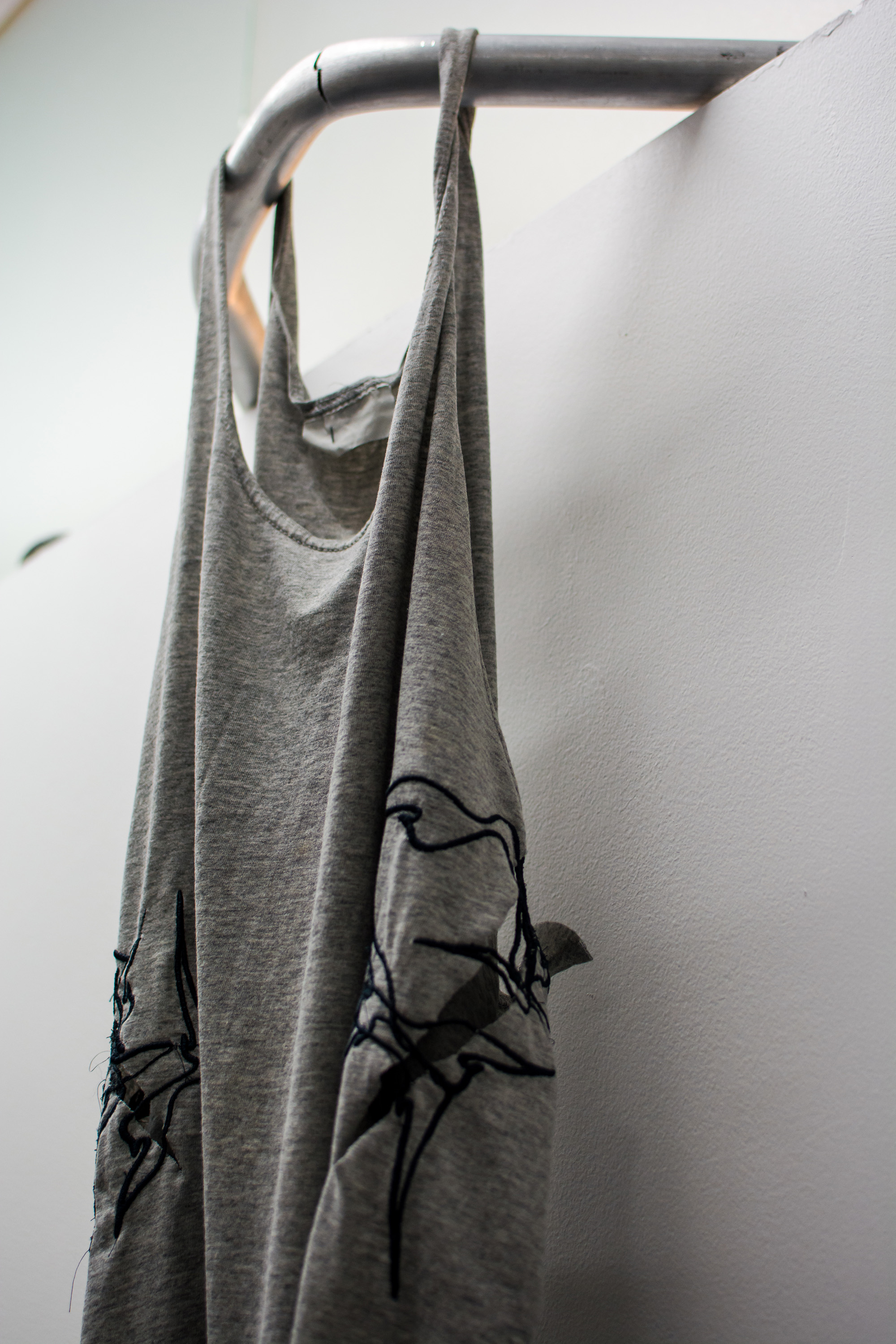 Laundered Fang (Tank Top) , 2016, Cotton, rayon embroidery thread, aluminum, hydraulic pressure