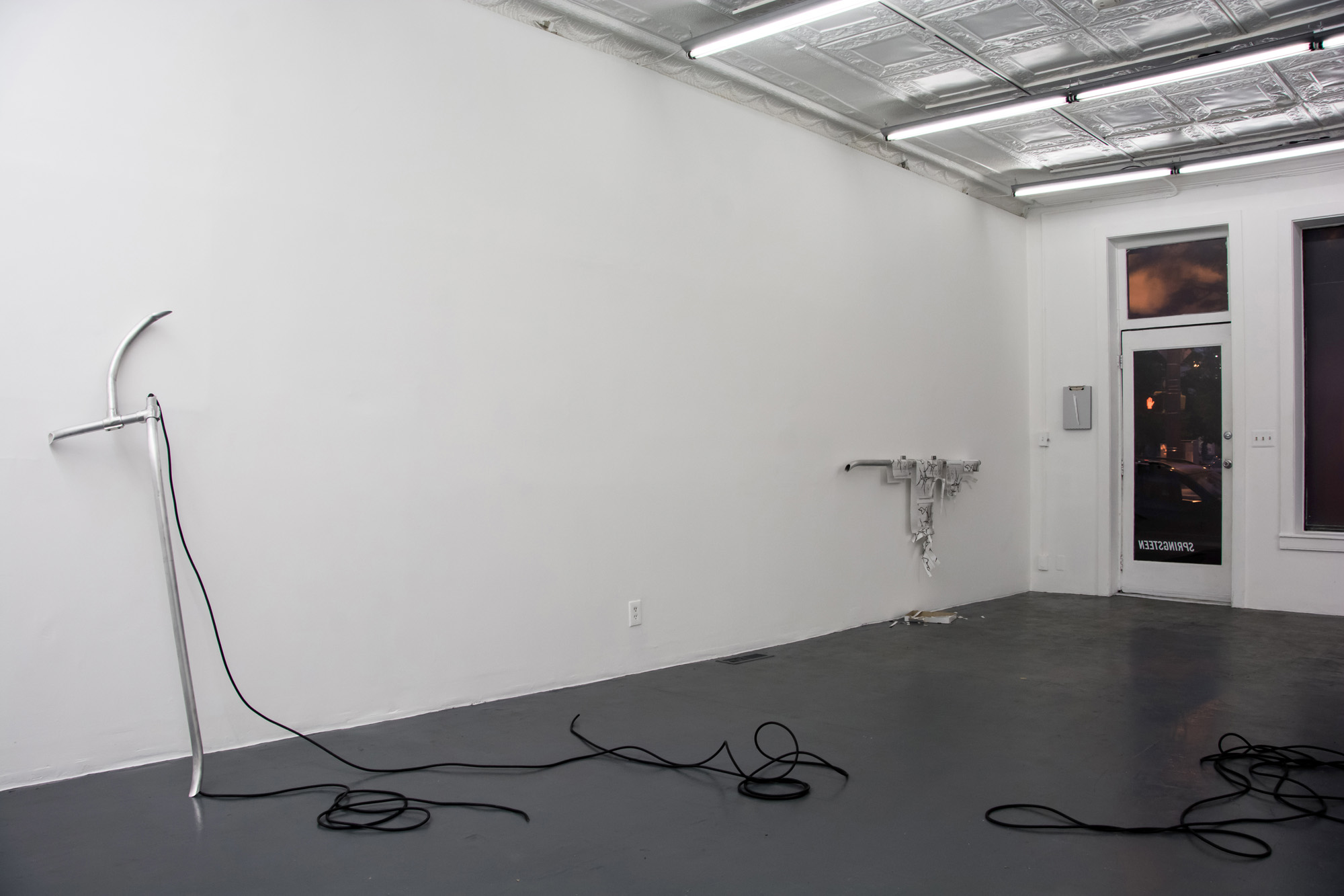 Laundered Fang (Gallery Main Room),  2016, Aluminum rail, hydraulic pressure, 6 AWG cable, T-8 Matrix(TM) guards