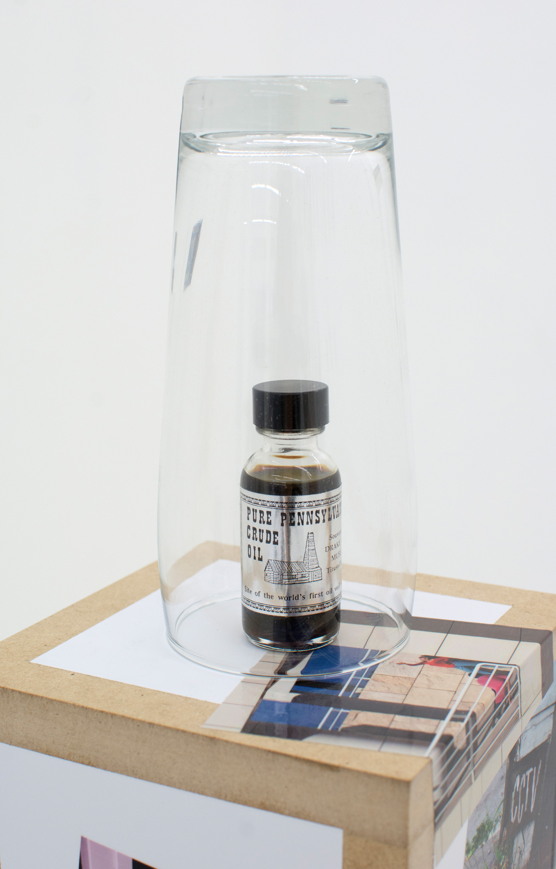 KEITH J. VARADI   Declaration , 2016, Crude oil sample (Oil City, PA), pint glass, custom plinth, adhesive vinyls (detail)