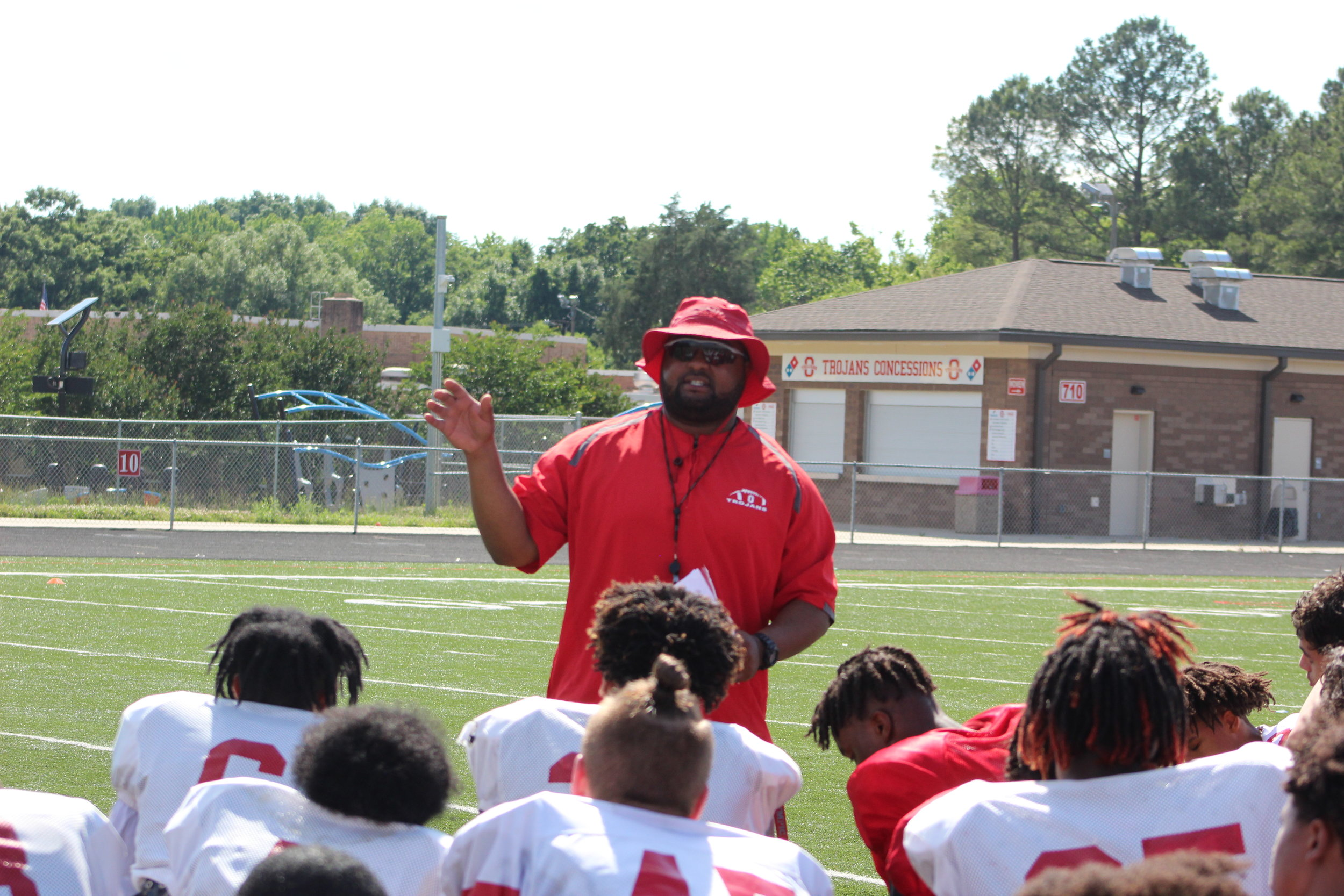 Olympic Head Coach Brandon Thompson addresses his team after Spring Practice