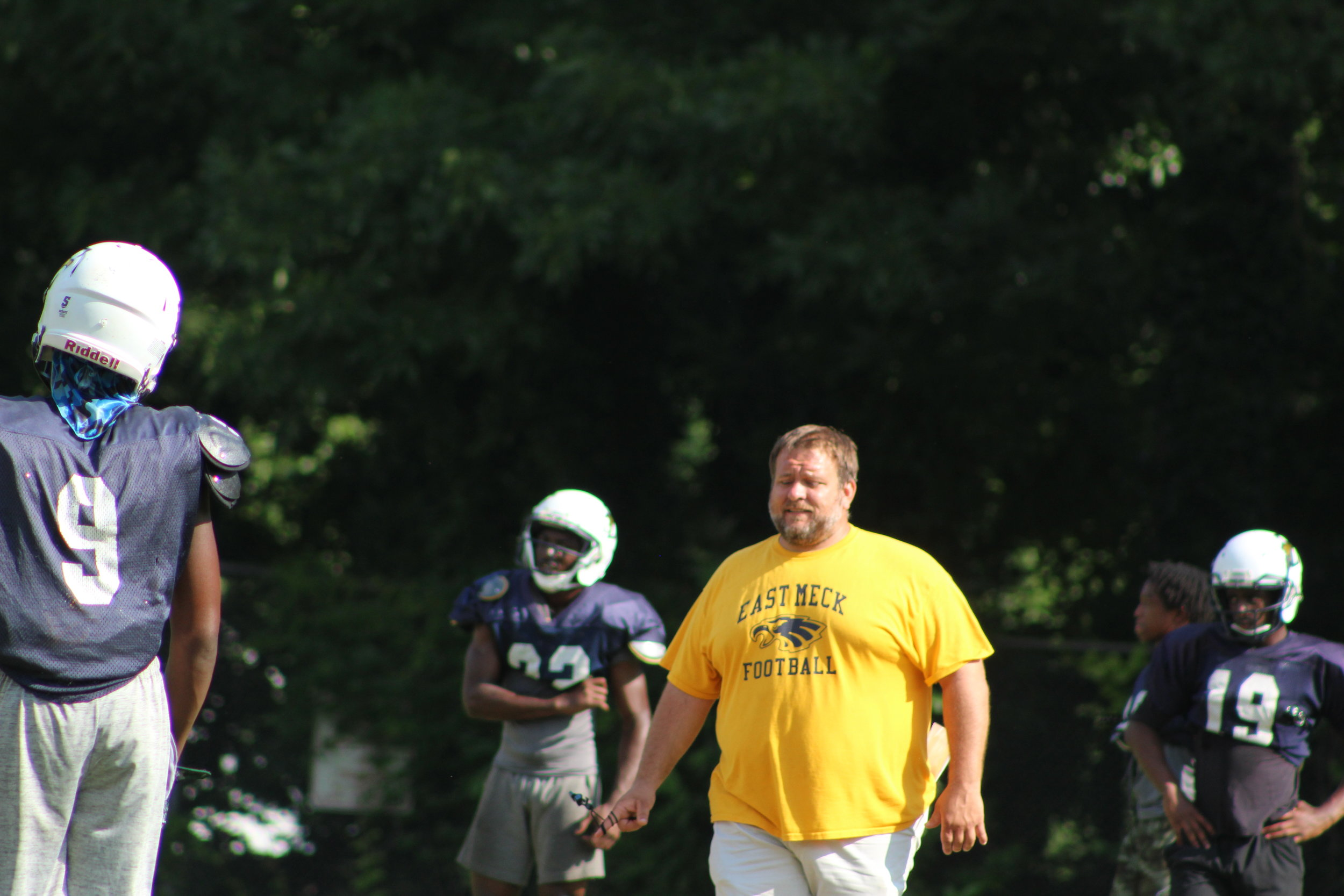 East Mecklenburg Head Coach Forshee Leads His Defense In Spring Practice
