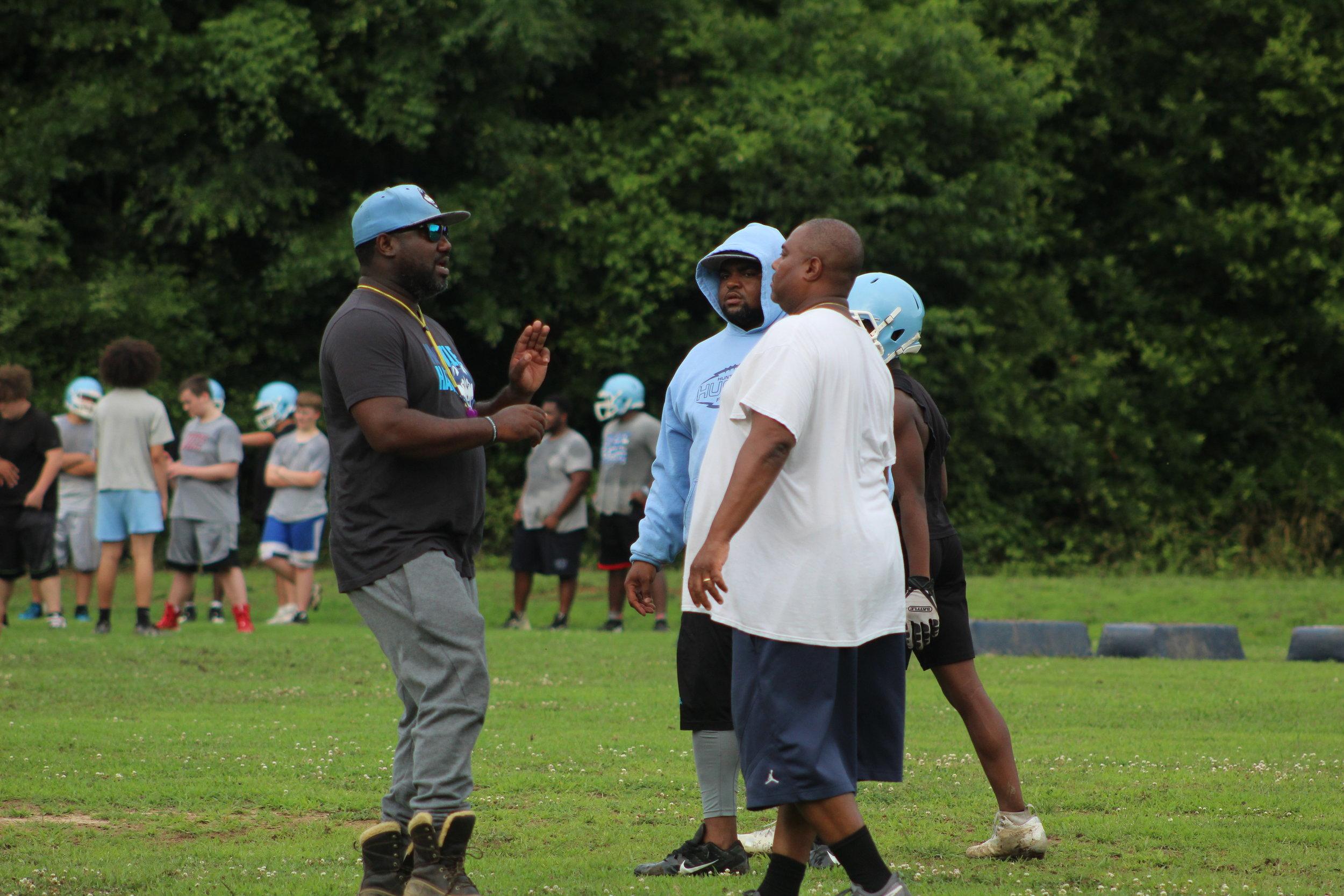 Hunter Huss Head Coach Jamar McKoy speaks with his assistants during practice