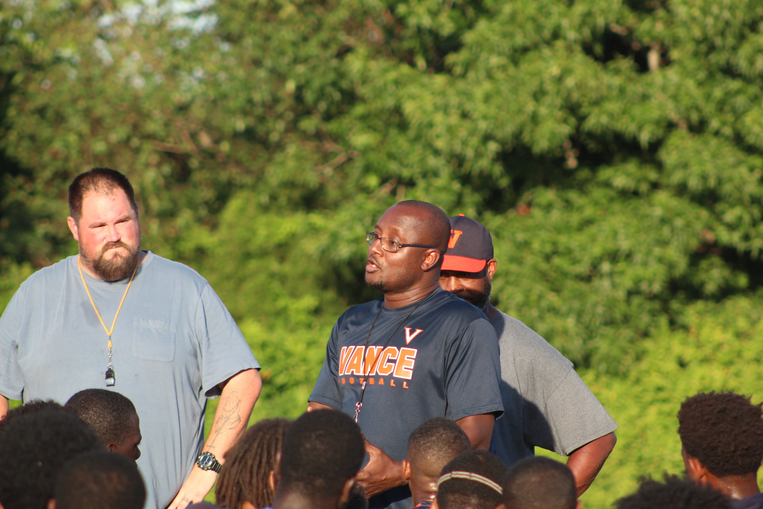 New Vance Head Coach Glenwood Ferebee speaks with his team at the end of practice