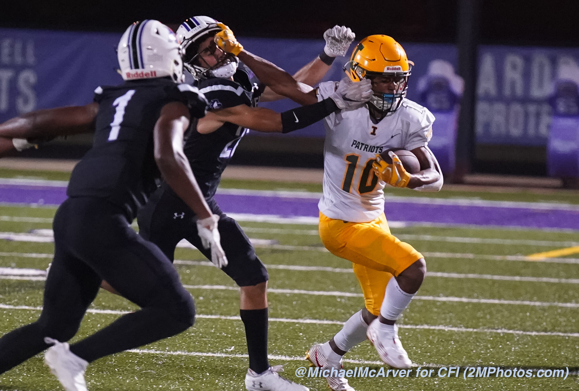 Patriots WR #10 Brevin Caldwell with the stiff arm.