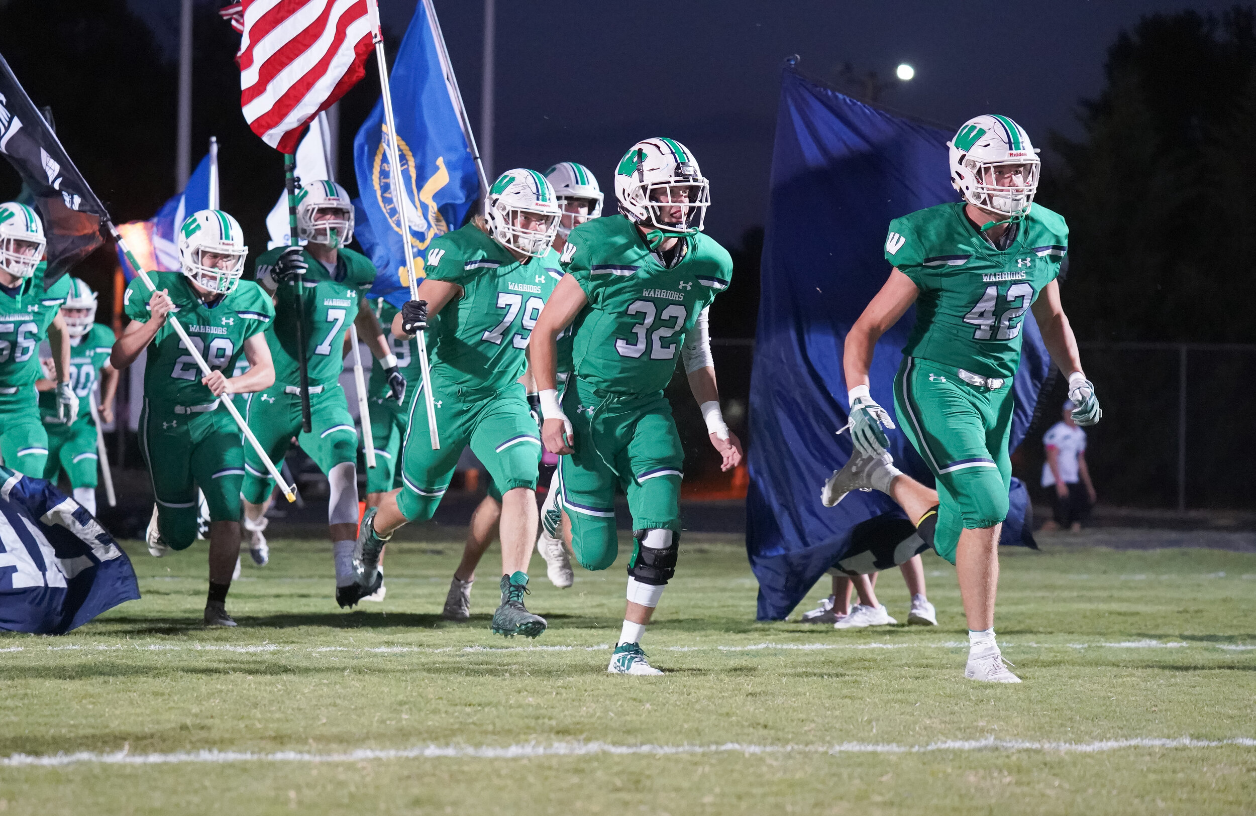 The 5-0 Weddington Warriors take the field in front of a packed house.