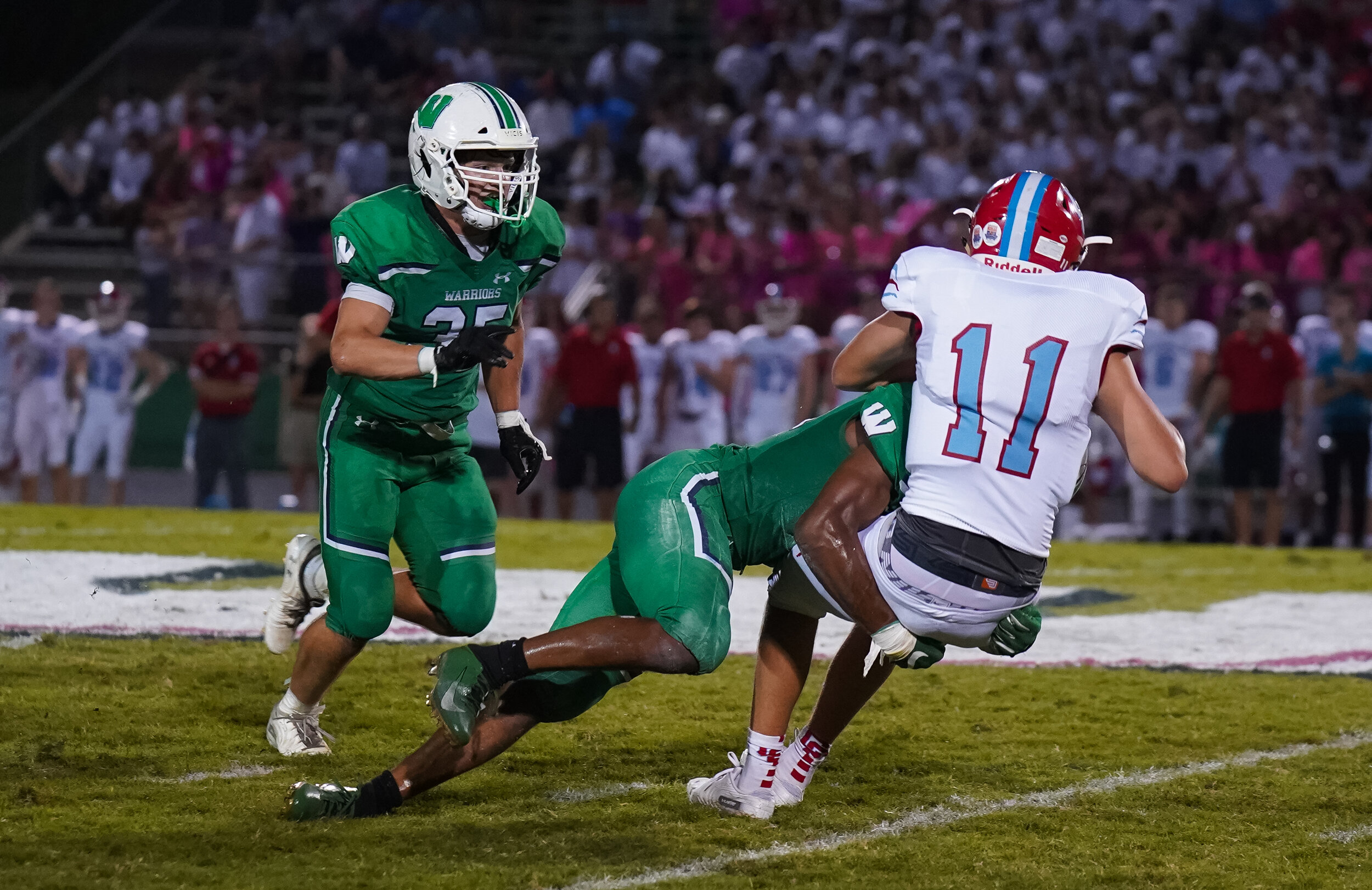 Weddington's DE/OLB #33 Trey Alsbrooks delivers a big blow sacking the Catholic QB #11 Jake Smith