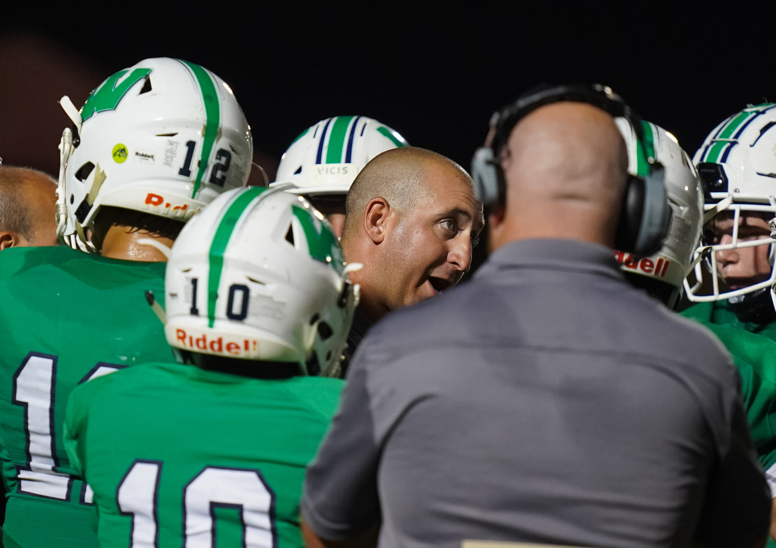 Weddington Head Coach Andy Capone talks to his offense.