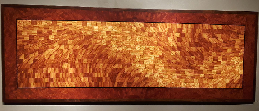 """river current""""54"""" x 20""""ByThomas schrunk - Central flow etimoe (African rosewood), border Indonesian madrone, Chilean walnut edge. The inner flow pattern is of etimoe (African rosewood) with an Indonesian madrone burl border and Chilean walnut edge."""