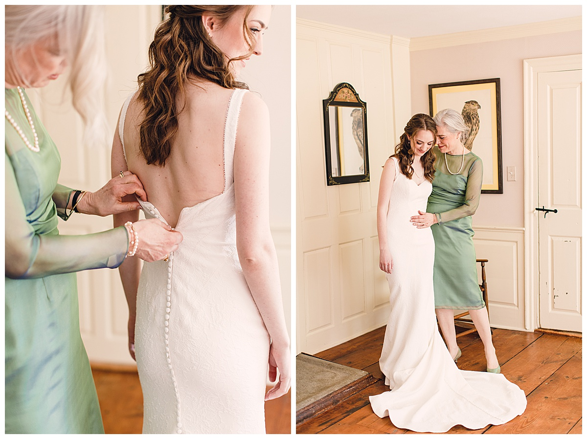 bride getting dressed with mother
