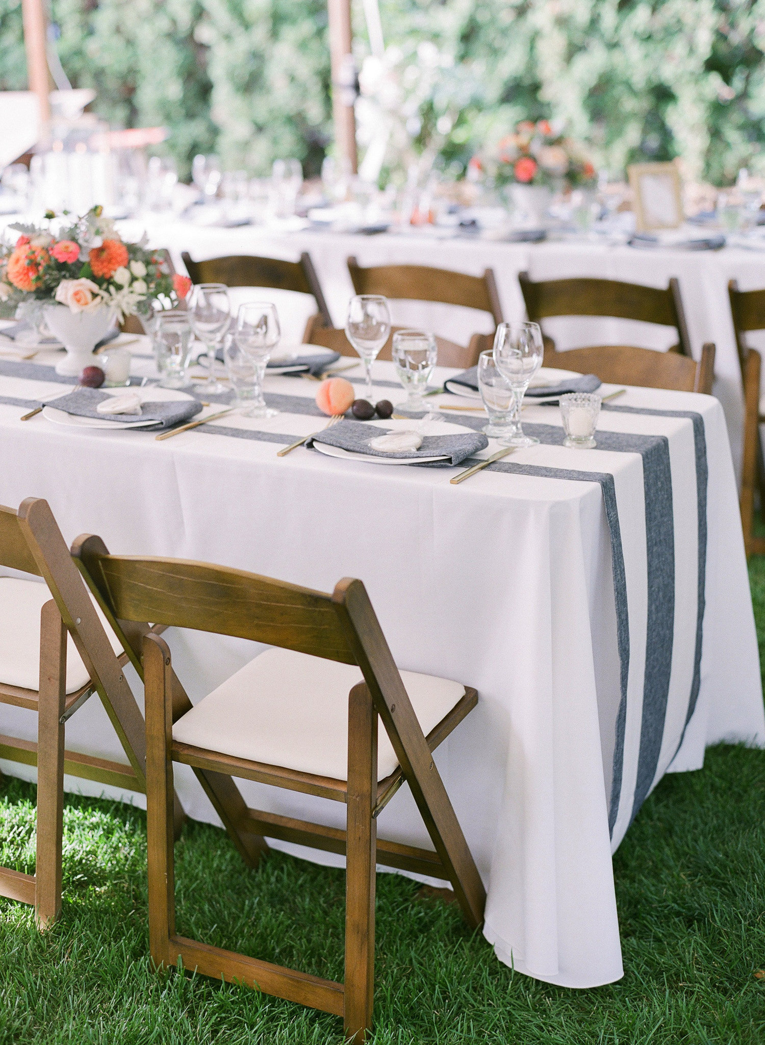 One of our past bride's is a big fan of stripes. She has multiple clothing items in this pattern, so we decided to make it a prominent design element. These runners from  Faire La Fete  are not only gorgeous, but instantly make the space feel personalized. Photography:  Blush Wedding Photography