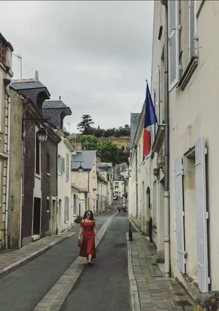 Down a humble stone corridor lined with little clean shops with one flying the French flag.