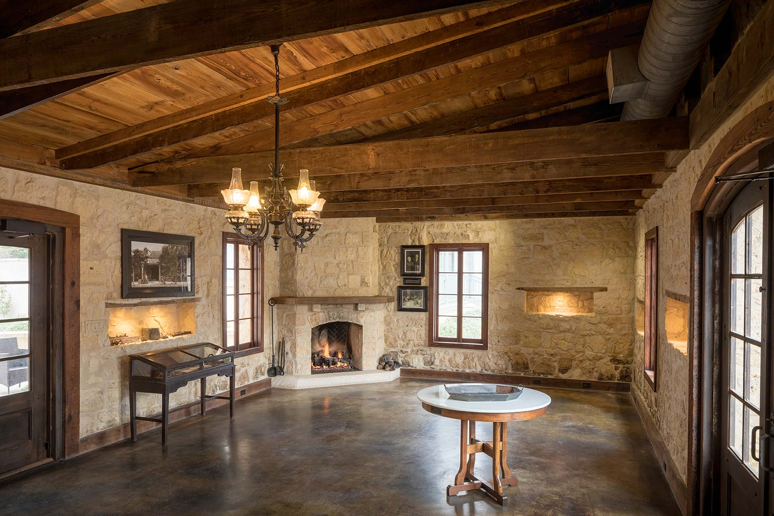 blacksmith-quarters-fredericksburg-realty-texas-commercial-real-estate-for-sale-cabins-fireplace.jpg