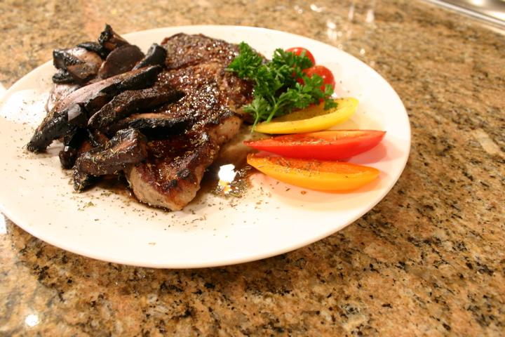 Grilled_Rib_Eye_Steak_with_Portobello_Mushrooms.jpg
