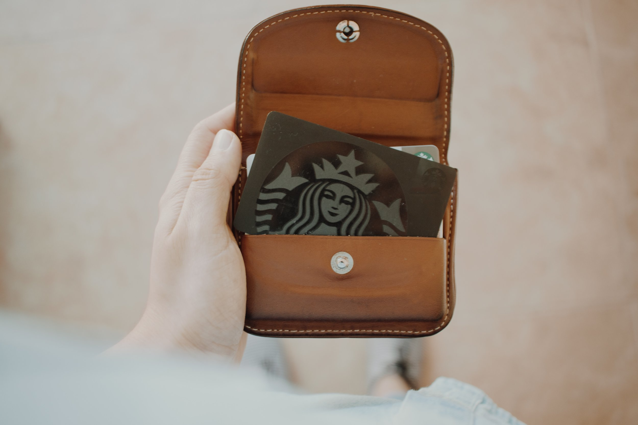 Starbucks loyalty card: Photo by Rebecca Aldama on Unsplash