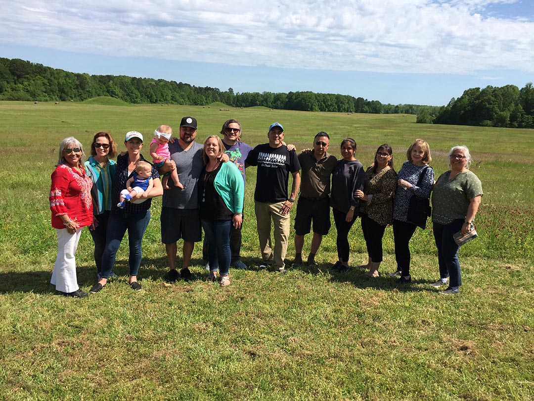 Visual Voices artists and family members pose in front of the Pharr Mounds while touring our Mississippi Homelands.