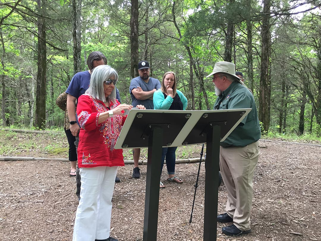 Visual Voices artists and family members read interpretive signs about plants used by our ancestors in Mississippi.