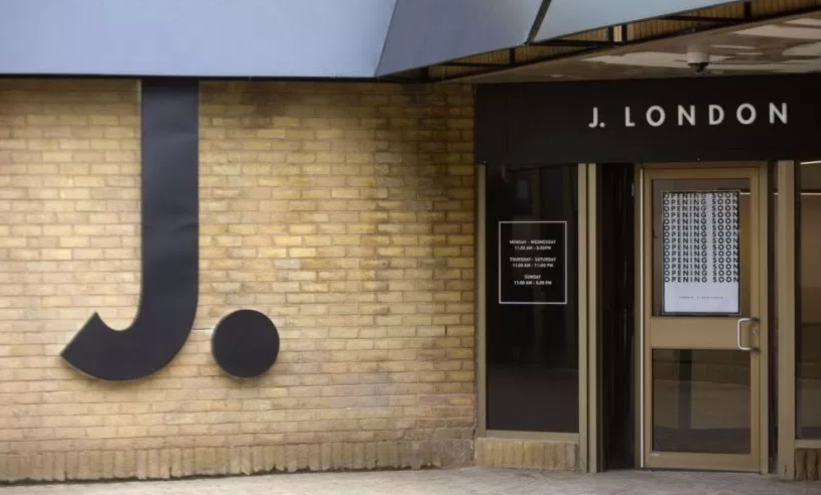 J. London has external signage ready for their opening Wednesday. (Mike Hensen/The London Free Press)