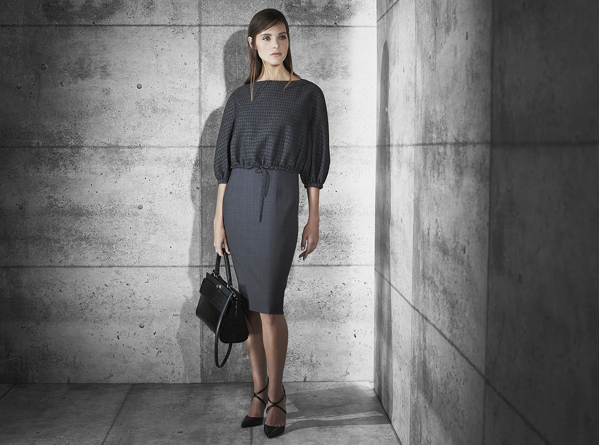 Gradient fine wool dress with abstract dimension wool over layer  black opal blue onyx   Patent with crocodile and fine texture calf-skin single handle bag    Contact Personal Shopper