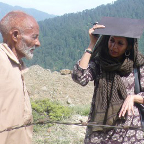 With Atta Mohammad (circa 1940-2016) who was forced to become the gravedigger and caretaker of the unknown and unmarked graves (in the background) at Chehal Bimyar in Kashmir.