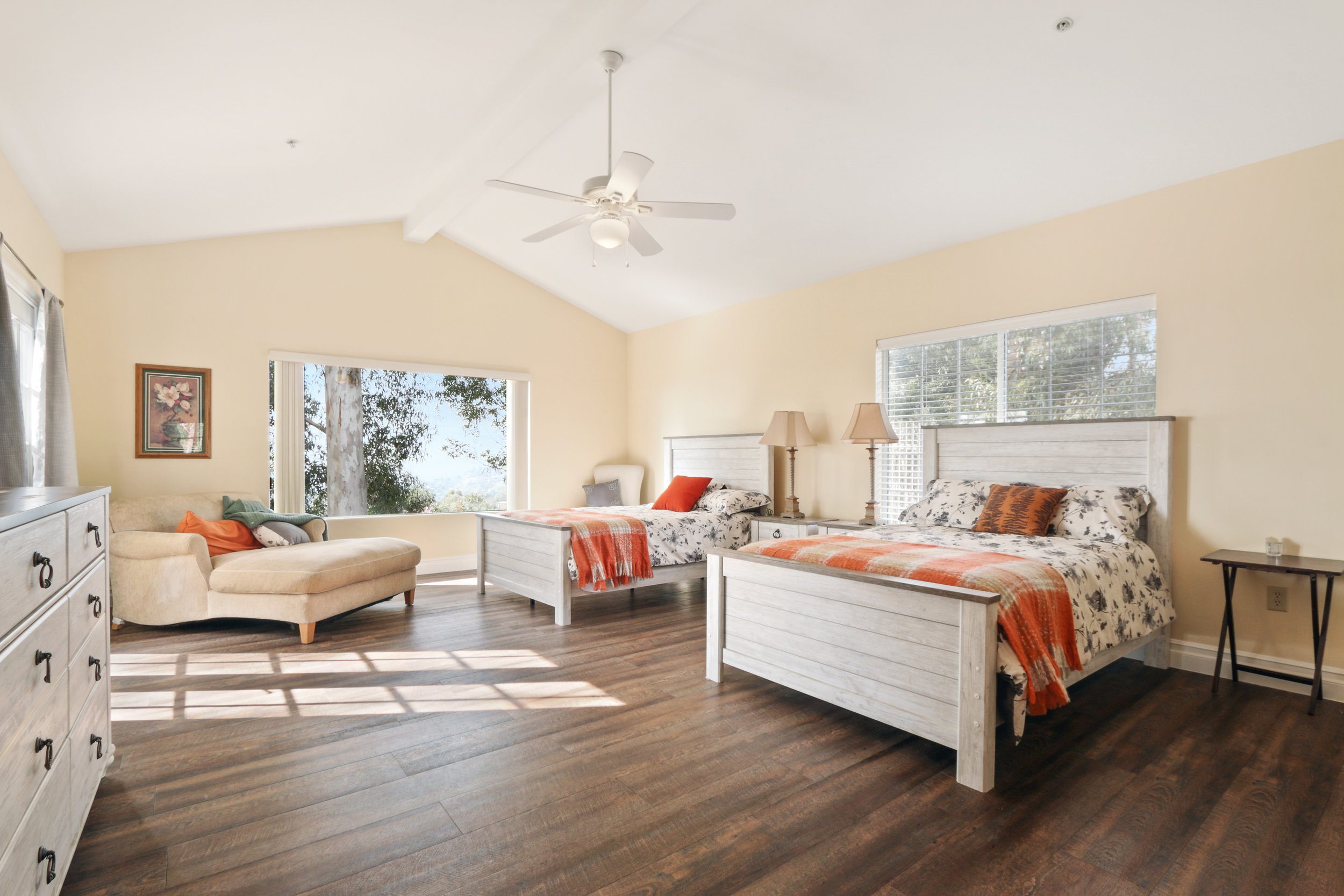 ROOM #1 -Dianne Lamming - Spacious bedroom with vaulted ceiling that offers a breath of fresh air.