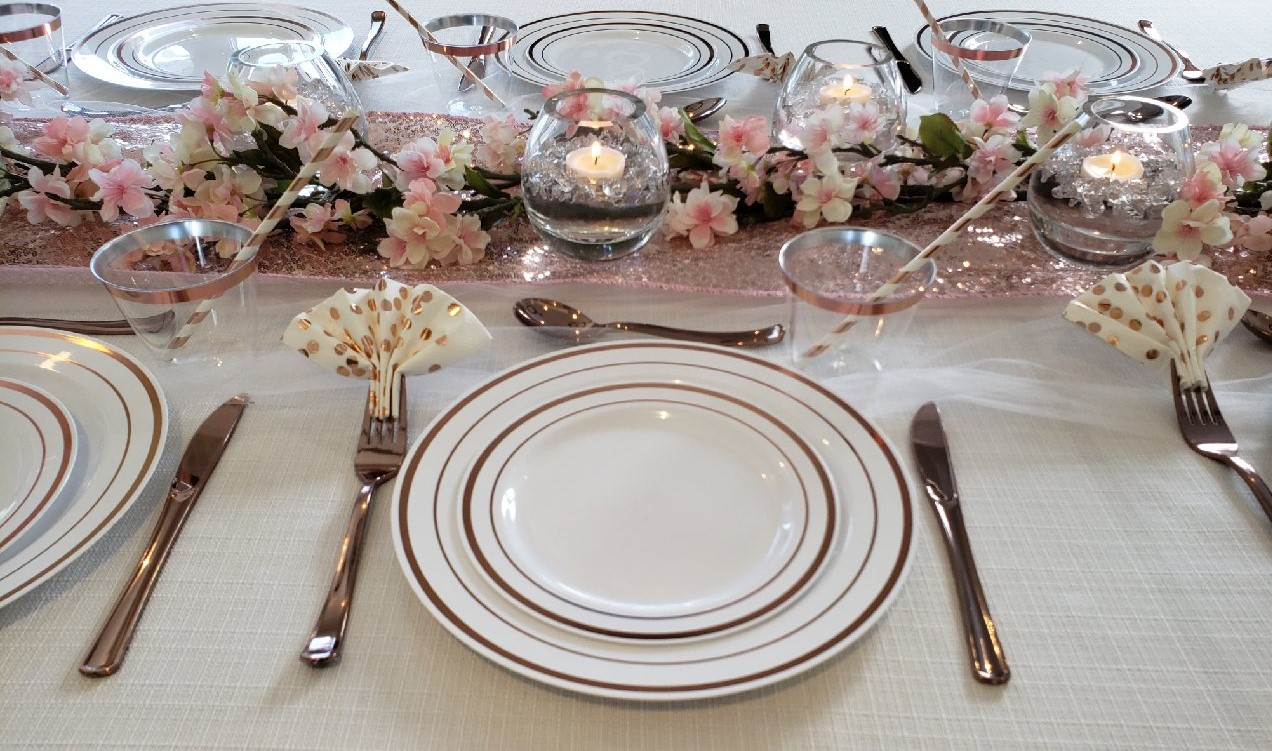 The Perfect Table - White table cloth, rose gold runner, round vases with floating candles, pink flowers, rose gold tableware and you have the perfect table for any guest!