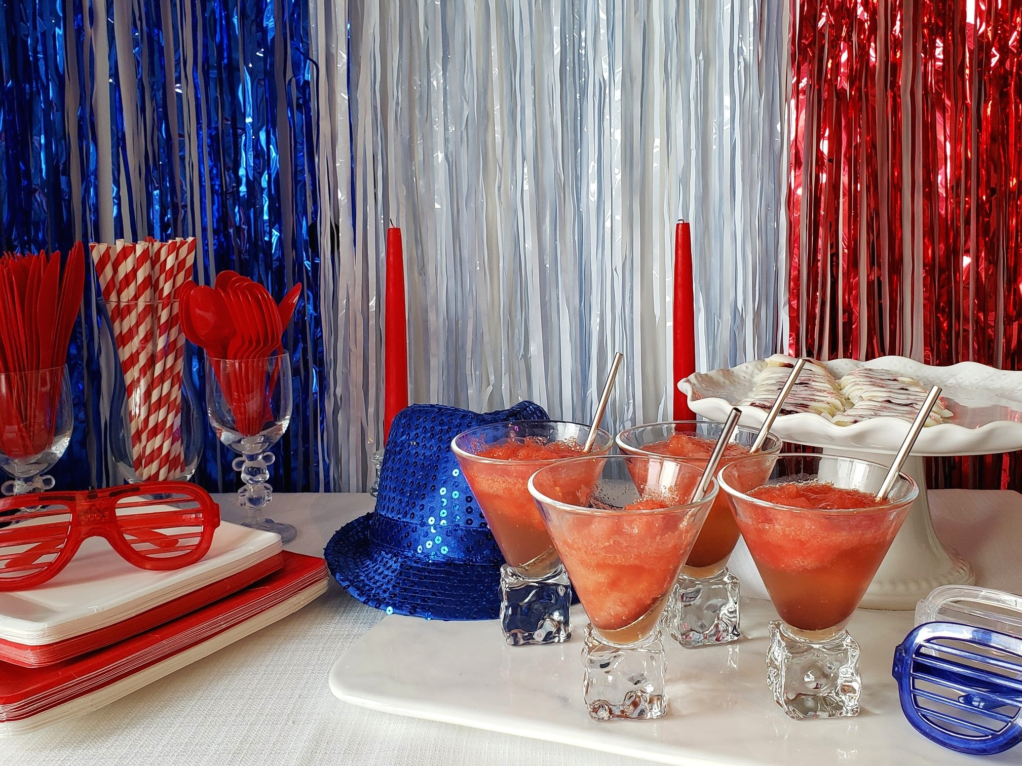 July 4th Party! - For our July 4th party, we chose to keep things simple. Red, white and blue fringe curtains for our backdrop, simple red and white plates and cutlery, easy watermelon slush and jam diagonals!