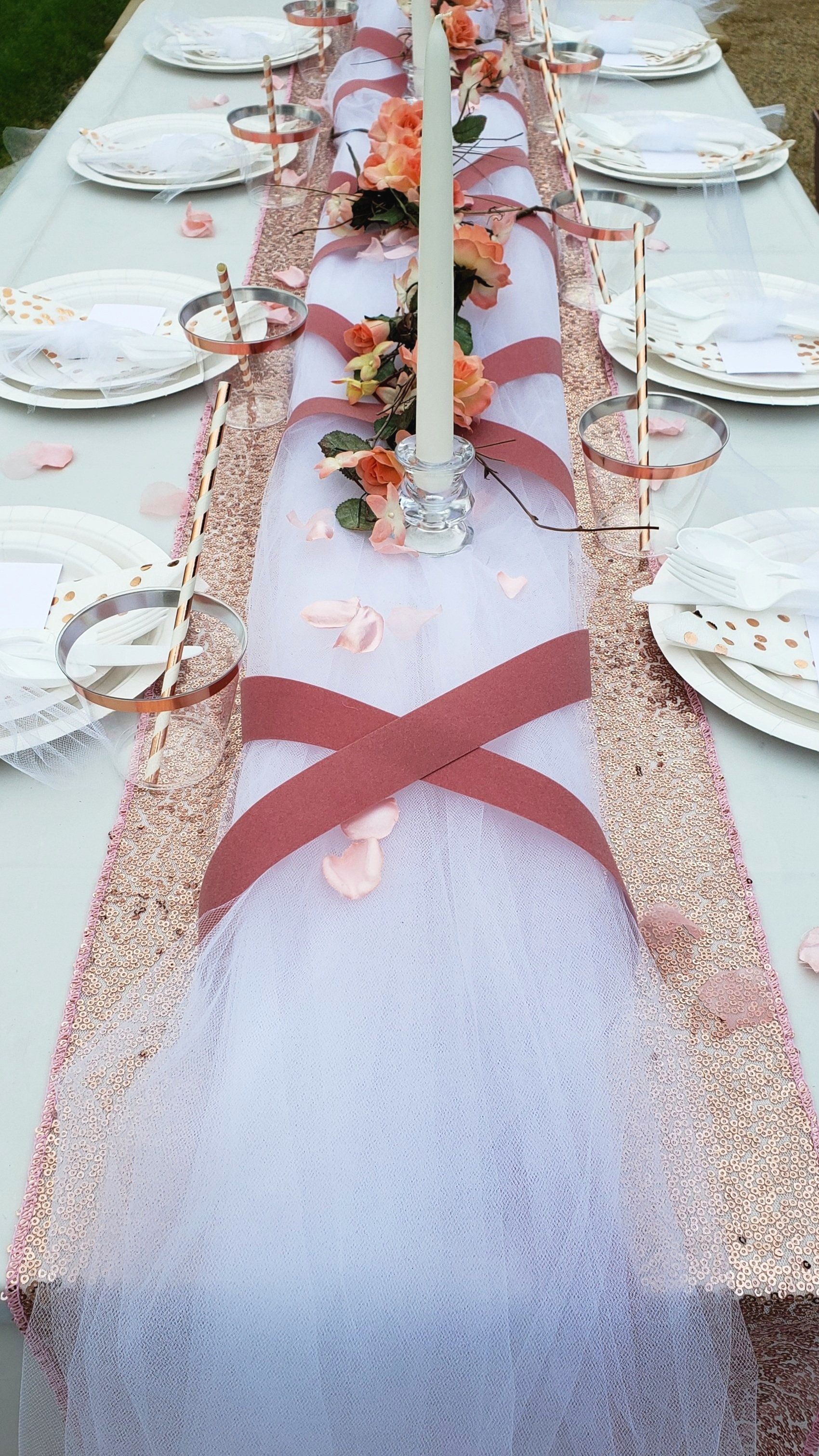 Tulle and velvet ribbon add a stunning layer over a sequin table runner.