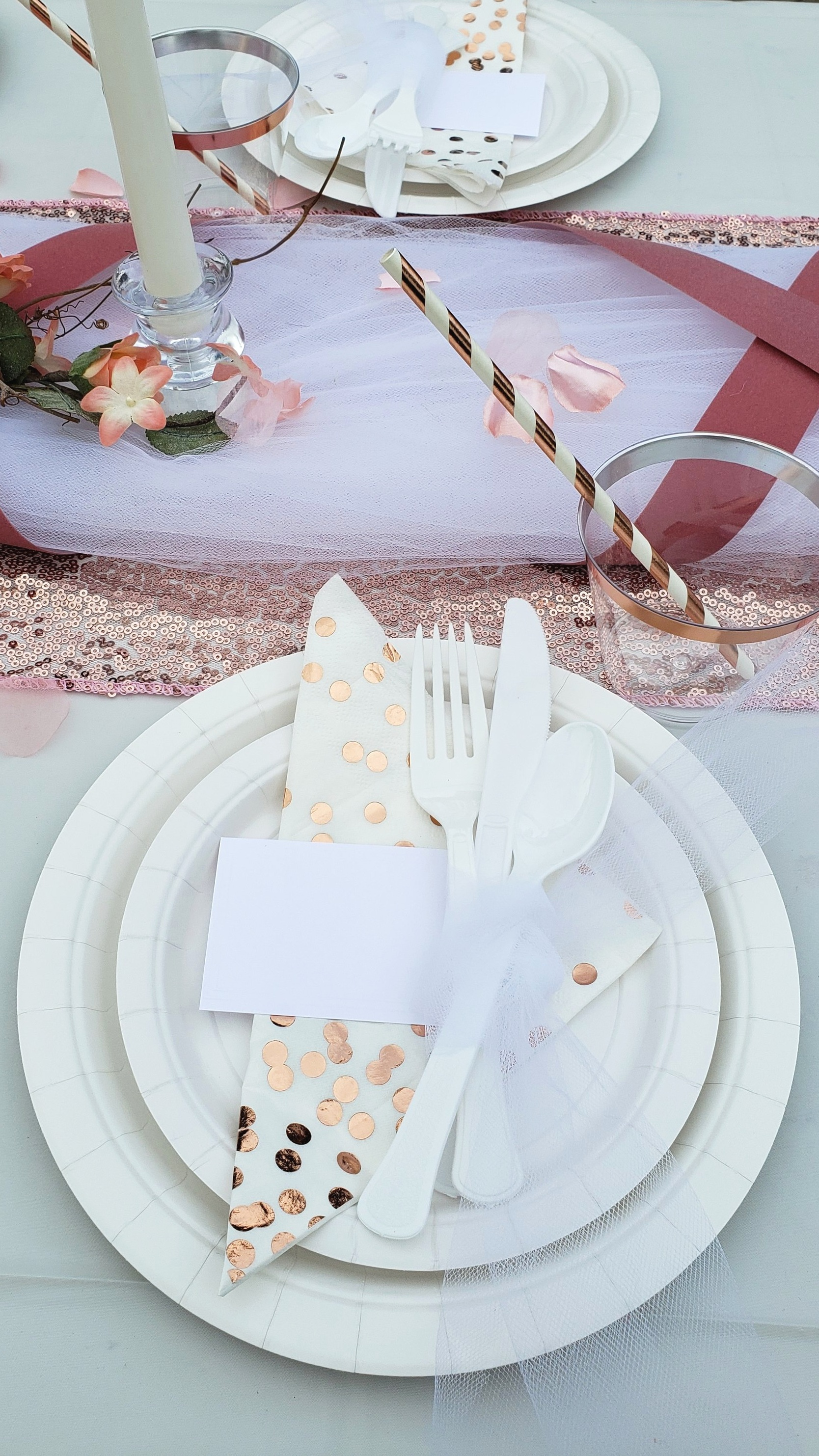 Wrap tulle around cutlery and tuck a place card under for added elegance.