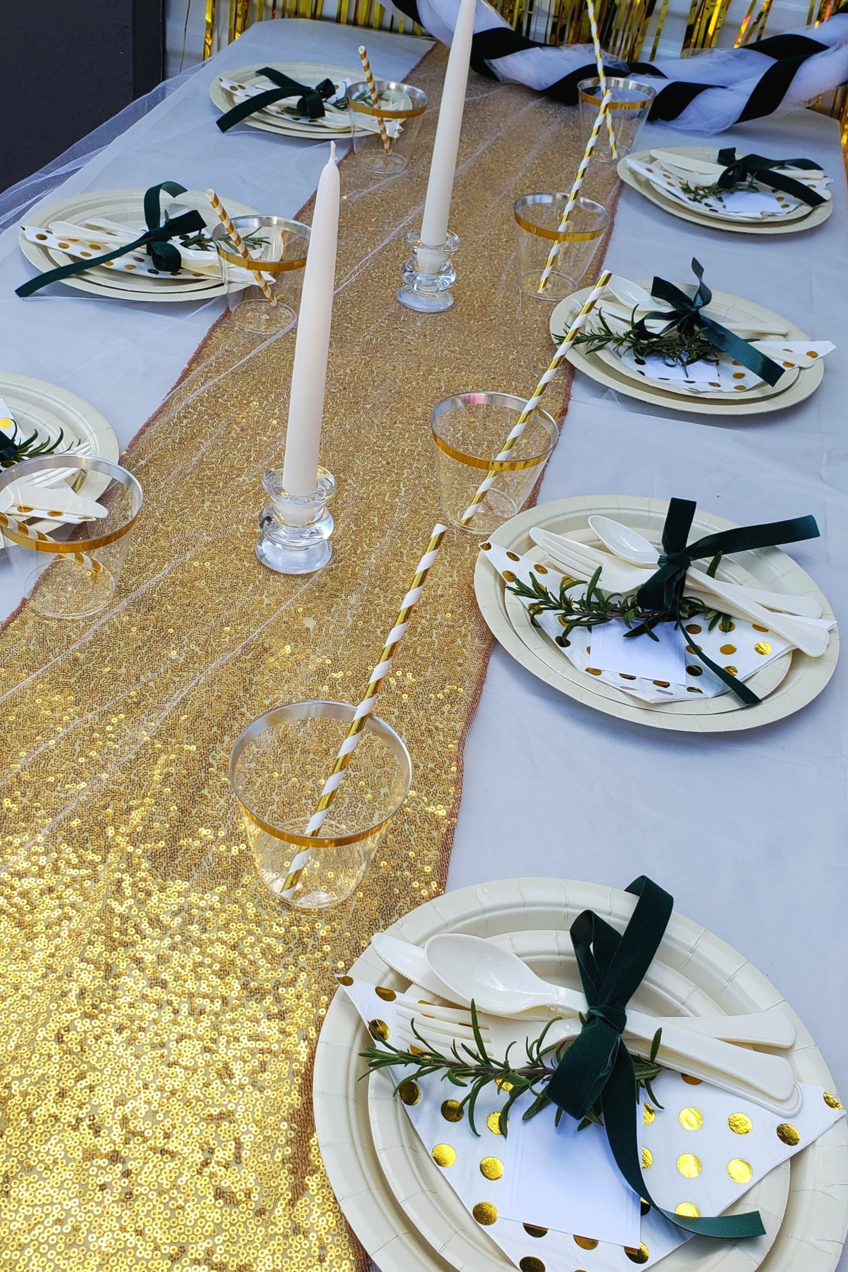Green And Gold - Love hunter green but not ready to paint your kitchen cupboards? Why not try it for your next party! We used gold fringe curtains, a gold sequin table runner, gold foil napkins, gold cups and straws then added hunter green velvet ribbon for accent. Tuck in a sprig of rosemary and you have a beautiful table setting! Don't forget to try our delicious chocolate oreo dessert. So easy, you will have it whipped up in no time!