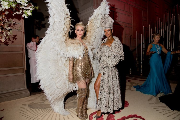 Katy Perry  (left)  in Versace; Rihanna  (right)  in Maison Margiela; Credit to  Kevin Tachman/Getty Images for Vogue