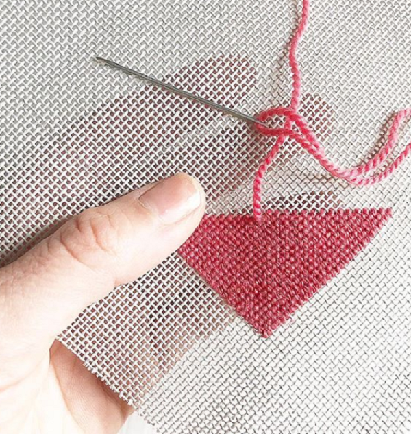Needlepointing in action