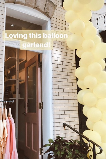 Mission Edit's balloon garland that they attached to our existing sign frame and hand rail. It was amazing and they made it themselves!