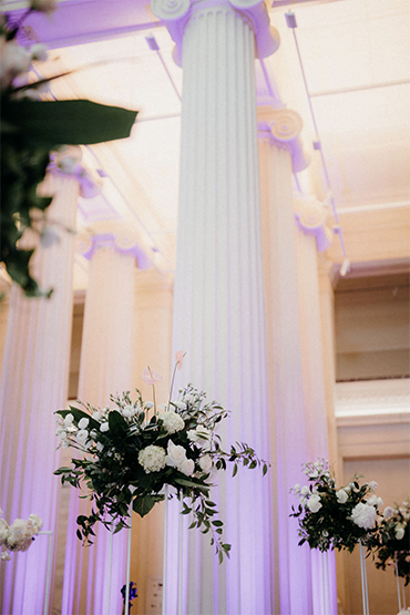 a touch of punk…floral sculptures sit amongst a strong purple-lit background, forming a striking contrast to the ceremony, filled with pretty pinks. we're into it. -