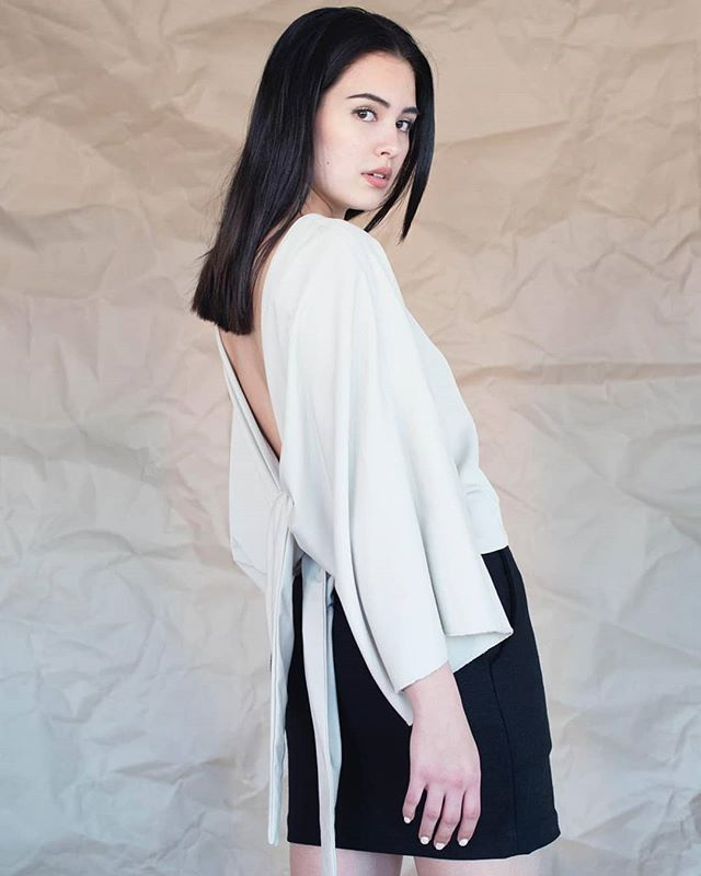 @mayaaboreslan looking amazing in our ANTHEA top!  Photo by @fredrika.eriksson Hair and makeup by @rosannalaaksonen  #lowcutback #offwhite #top #widesleeve #cleancut #model #modedesign #fashion #summer #collection #tietop #women #slowfashion #classic #timeless