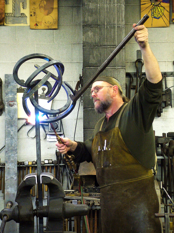 Fred adjusting sculpture copy.jpg