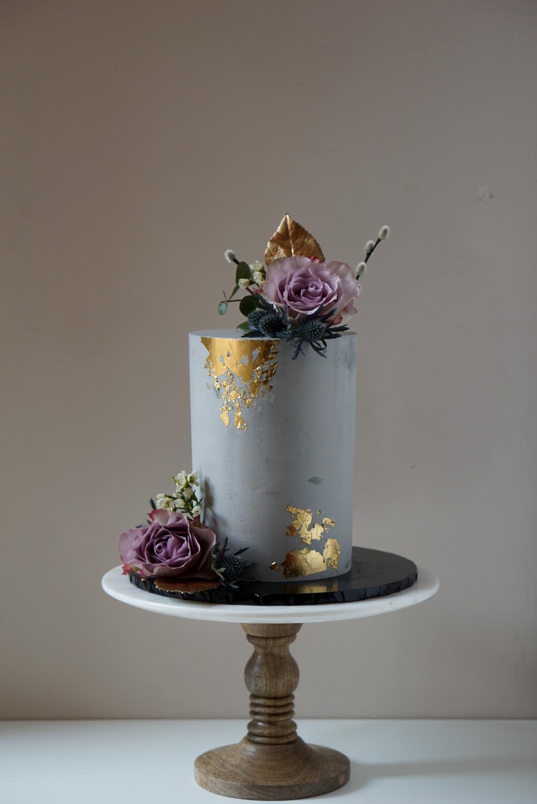 Concrete cake with gold leaf