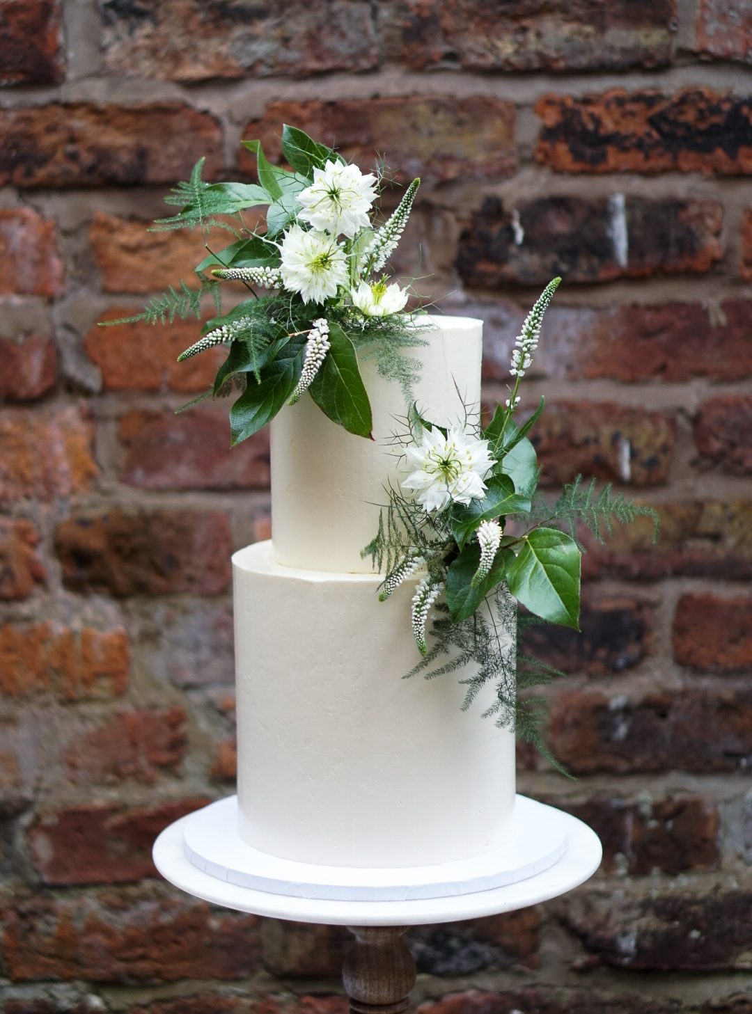 Green and white floral theme wedding cake in Cheshire