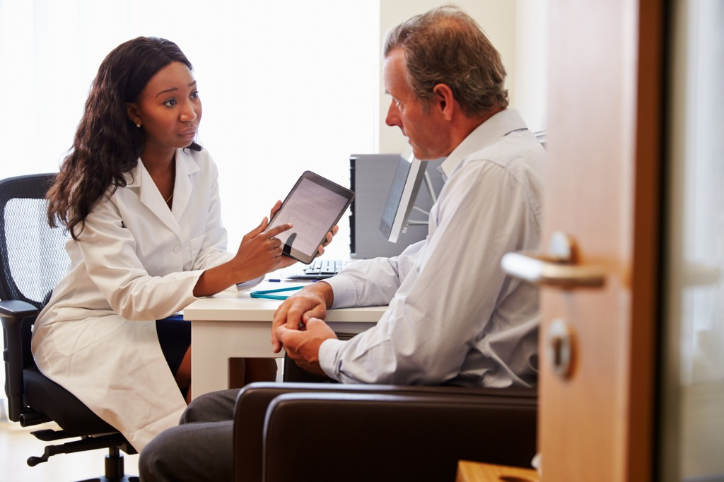 patient-having-consultation-with-female-doctor-in-office-picture-id489138736.jpg